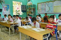 Children learning in class at Plan International supported schoo